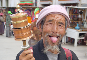 A man from Tibet, extending friendly greetings by sticking out his tongue