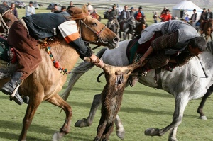 Kyrgyzstan Buzkashi players struggle for control of the goat