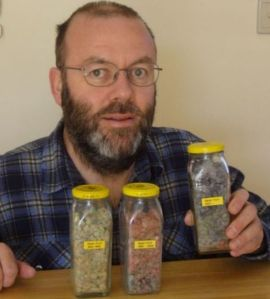 Graham Barker shows off 26 years worth of belly button lint